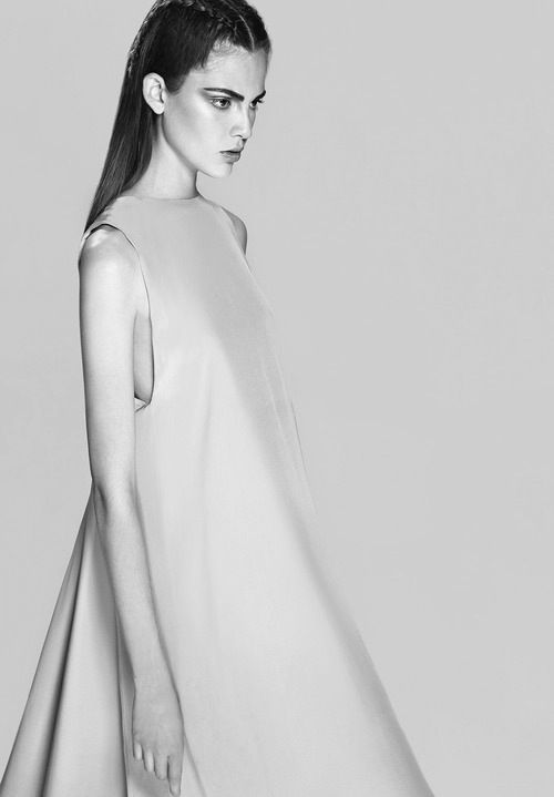 Minimalist Fashion - structured dress with clean lines & lightly flared silhouette; elegance in simplicity
