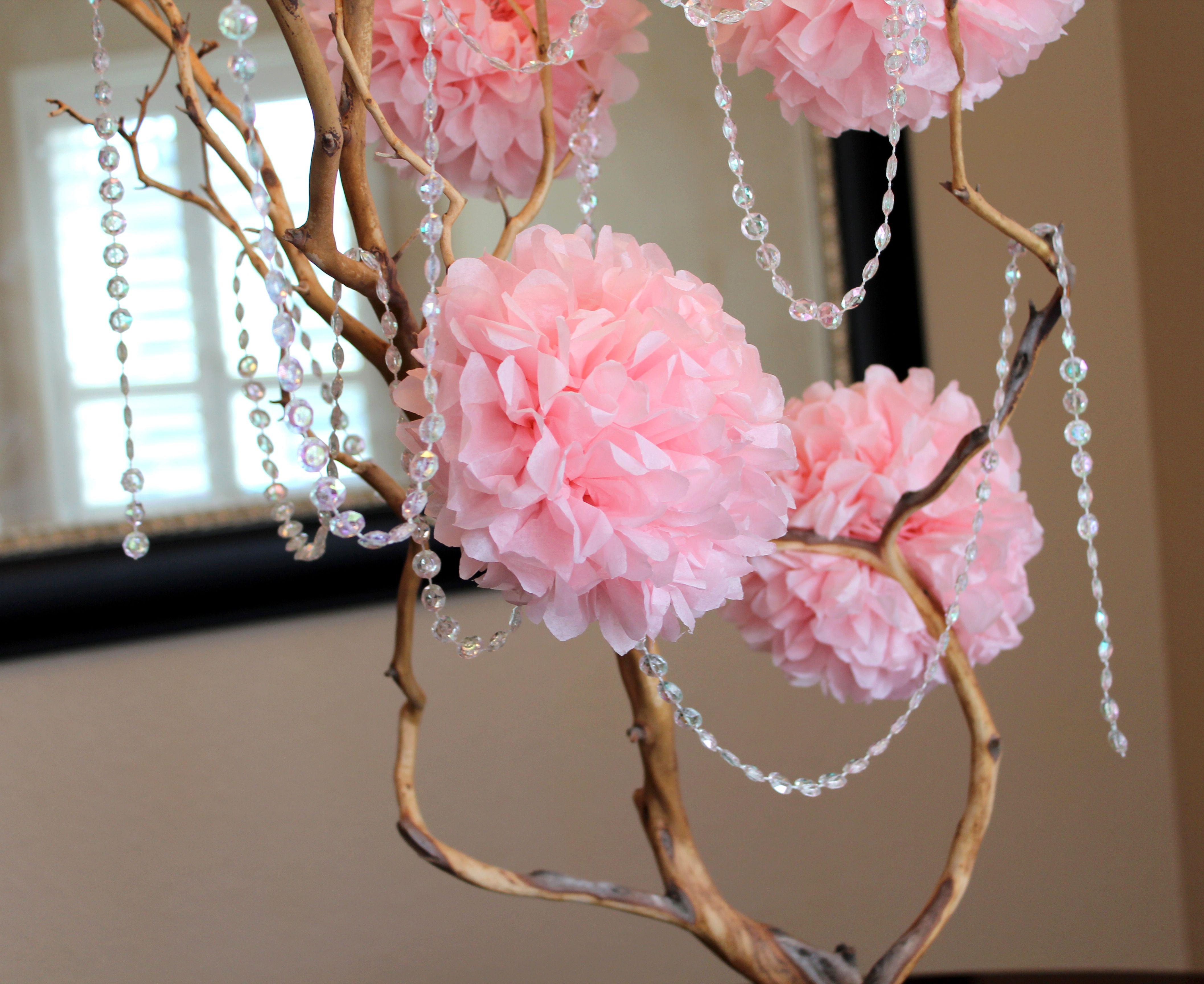 Diy manzanita branch centerpiece with pink pom tissue