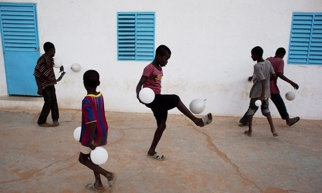 Boys play soccer with balloons after attending a dance recital about water shortage in the West African country of Mauritania. A reported third of the country's million people are at risk of malnutrition if rain doesn't fall by July.
