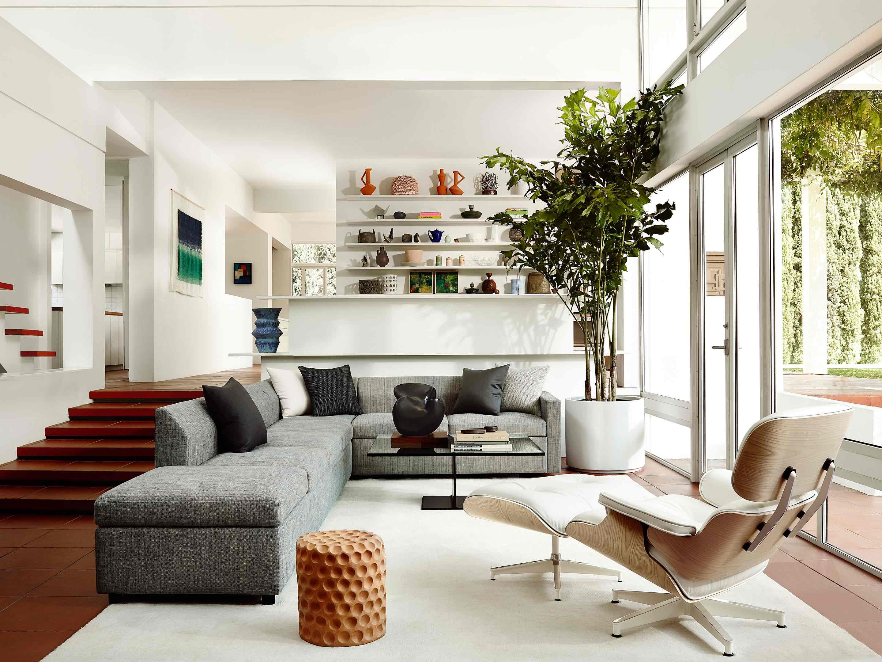 Eames Lounge Chair Living Room the eames lounge chair and ottoman live in stylish interiors