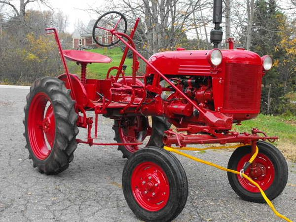 farmall cub our neighbor moved his yard with ganged reel mowers like