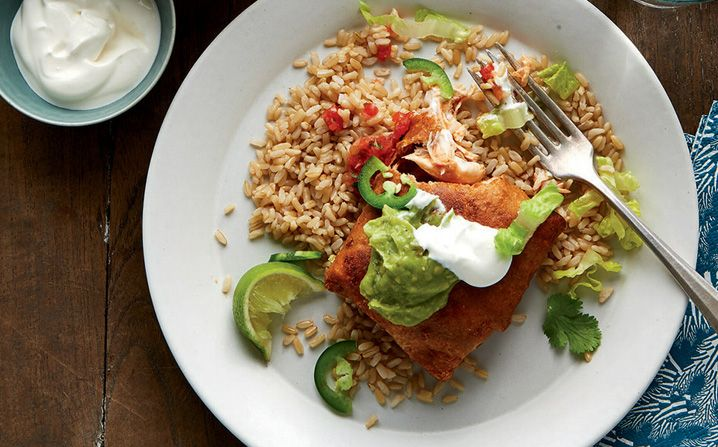 Freezer friendly homemade chimichangas? From the slow cooker? Why yes! It's possible!We've tweaked the classic deep-fried Tex-Mex favorite, making it quite a bit simpler (and a little less fried). You'll be wowed by this crowd pleaser freezer meal! #freezermeal #mexican #dinneridea