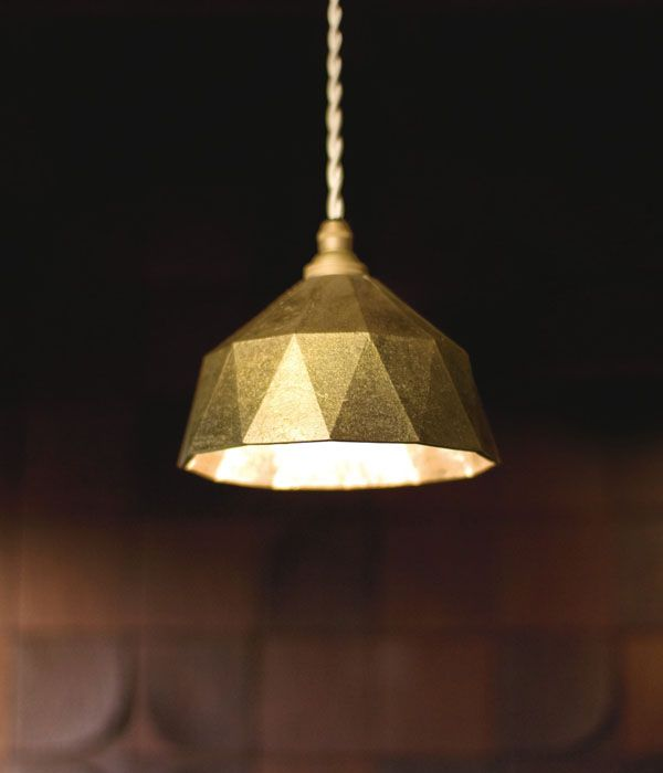 I fell in love with this pendant lamp at Mjölk last night, at an exhibition for Masanori Oji.  It's made with rough brass and the light it creates is beautiful.  New favorite light.