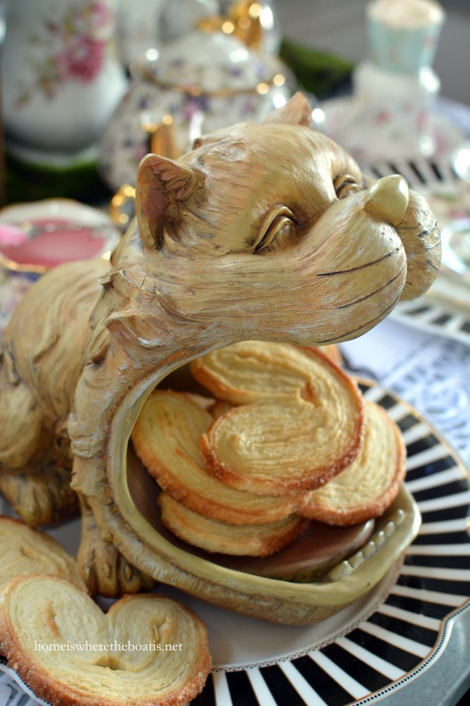 Cheshire Cat serving palmiers for Mad Tea
