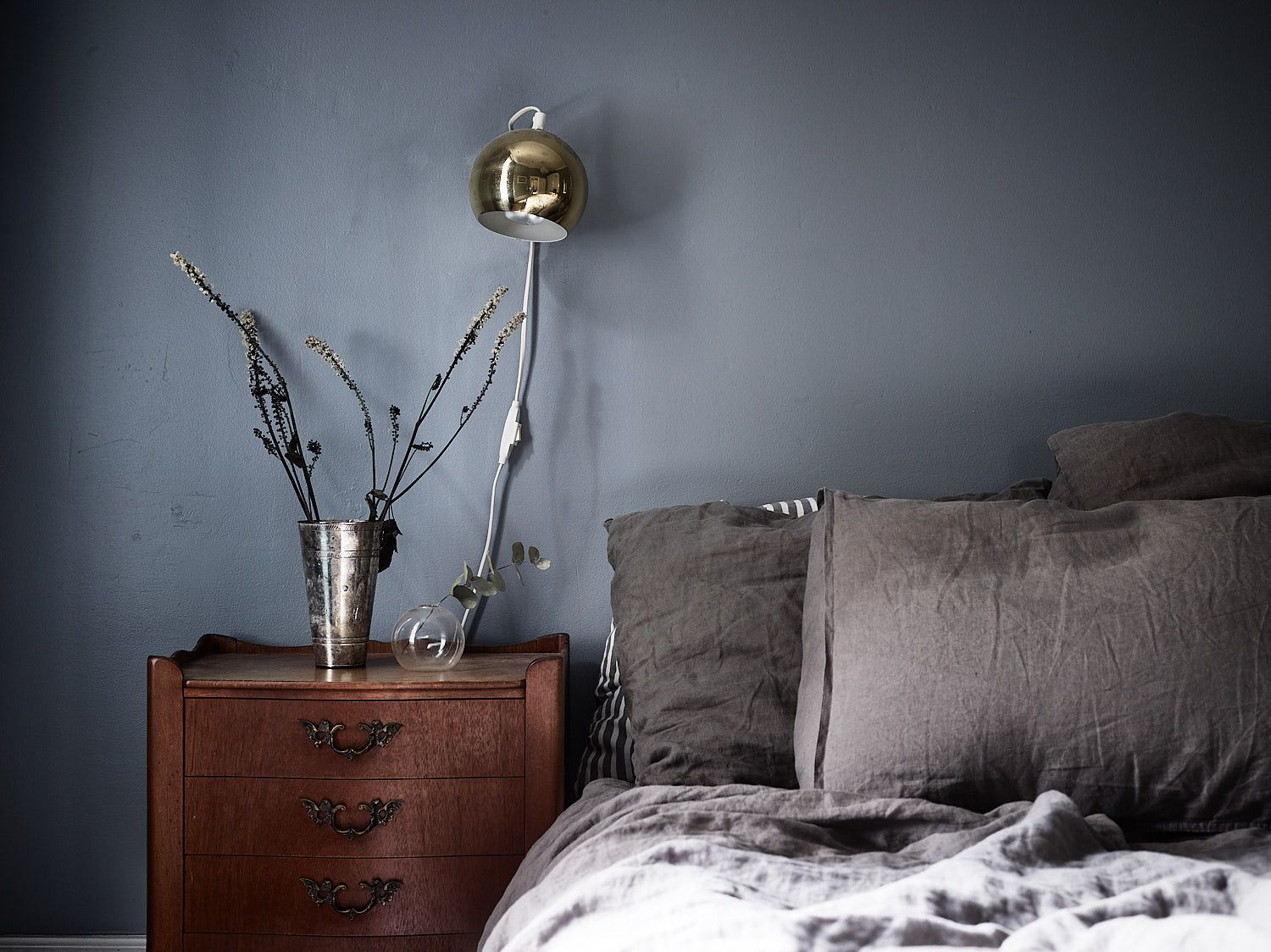Stylish muted blue bedroom is part of bedroom Blue Side Tables - I like this bedroom with walls painted in a mixture of blue and grey  The velvet blue curtains and the brass wall lights make this look chique, while as the antique wooden side tables add character to the space  via … Continue reading →