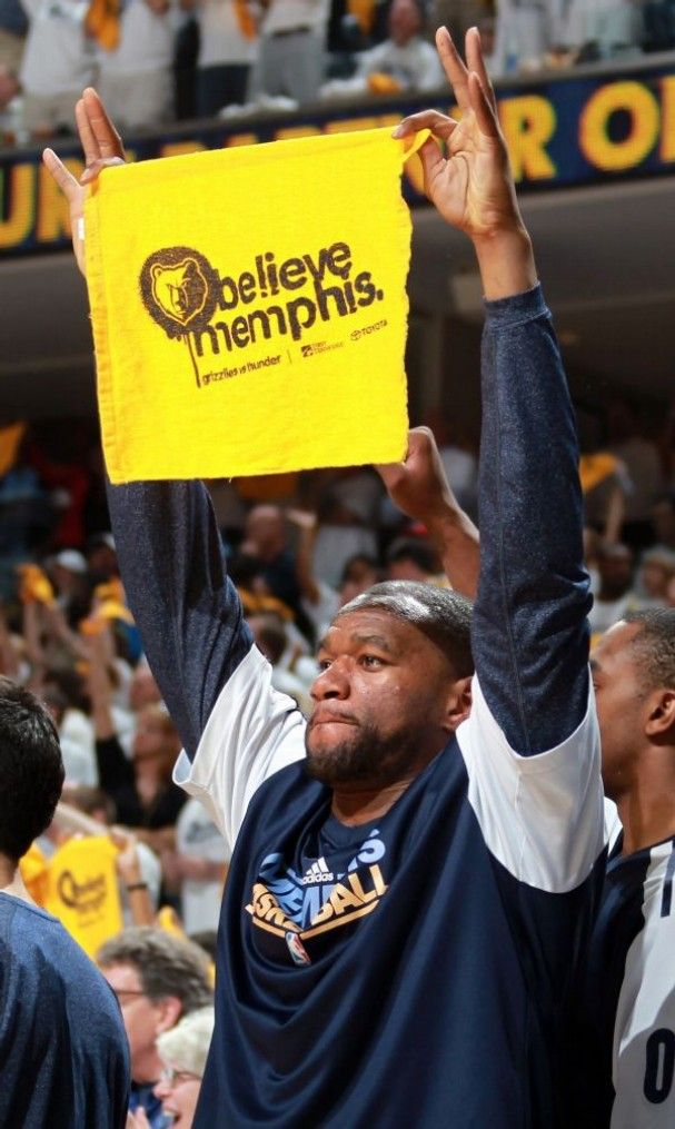 The Grizzlies' Sam Young shows off his Growl Towel.