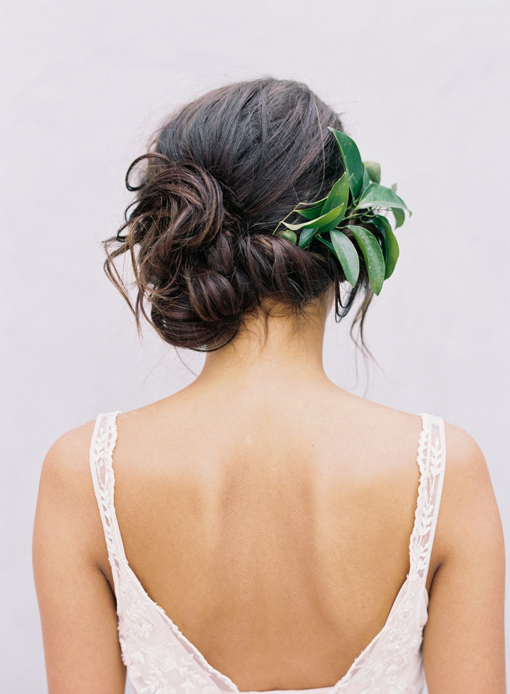a classic wedding updo, loose side bun, romantic side swept