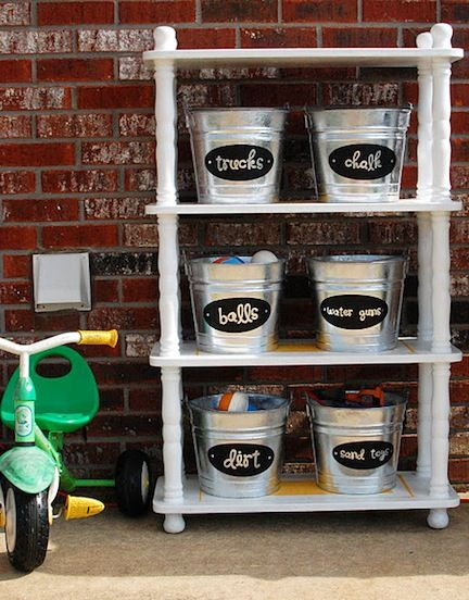 Kid shelf for garage and outside...use galvanized buckets with labels.