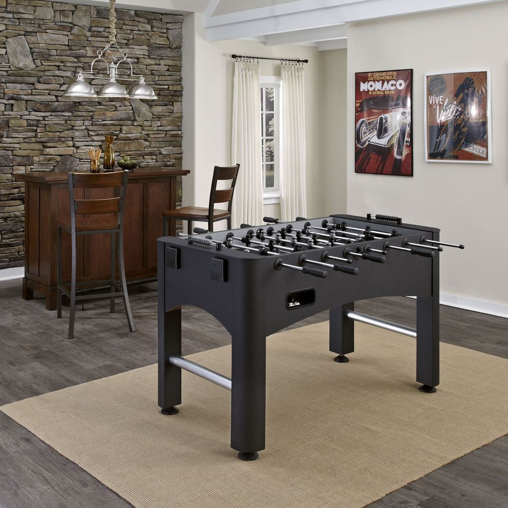 Keep your guests entertained with a fun game night that includes foosball.