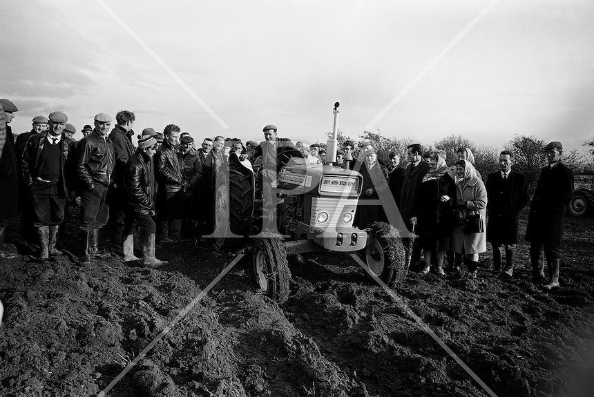 National Ploughing Championships at Tullow, Co. Carlow.  James Murphy, Carlow, winner of the Supreme Award, with his Ford tractor..26.10.1967 See more photos like this at www.irishphotoarchive.ie #vintage #oldphotos #blackandwhite #film #artistic #finearts #ireland #irishhistory #historyphoto #history