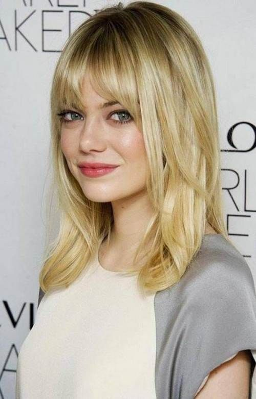 Medium haircuts for thick hair and round faces with bangs