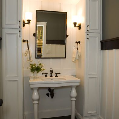 dark floor, white paneling, dark chair rail, green paint