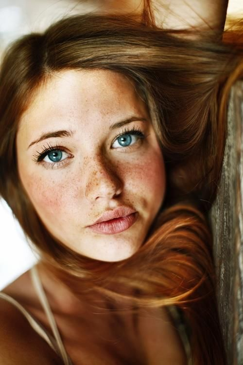 Redhead freckles and blue eyed women