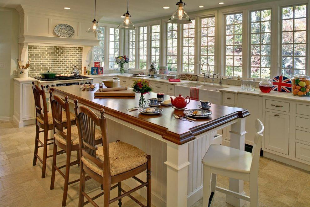 Full wall of windows in kitchen, including wrap around the