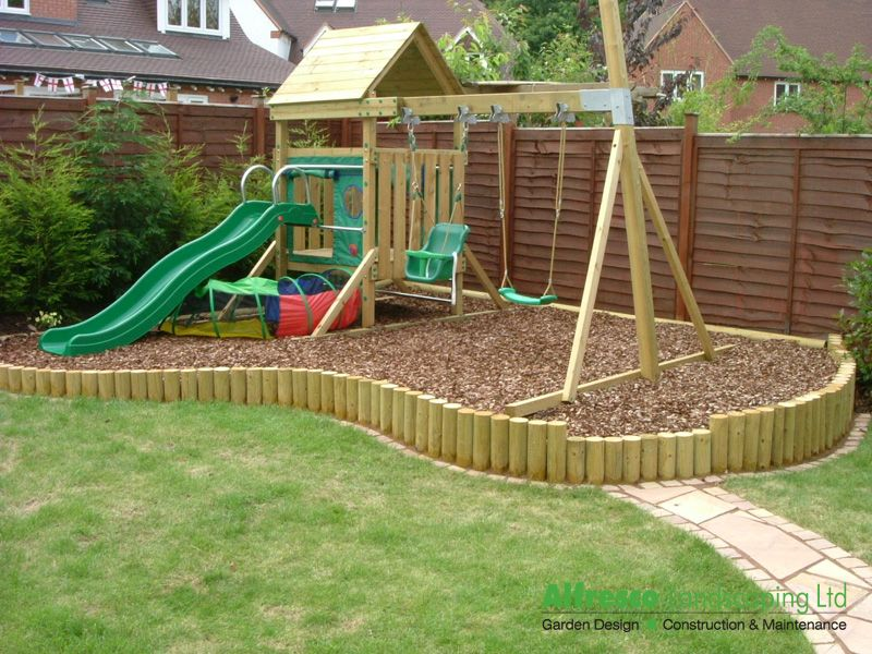 garden with play area raised area for play equipmenttrampoline etc but with artifiial grass rather than woodchip