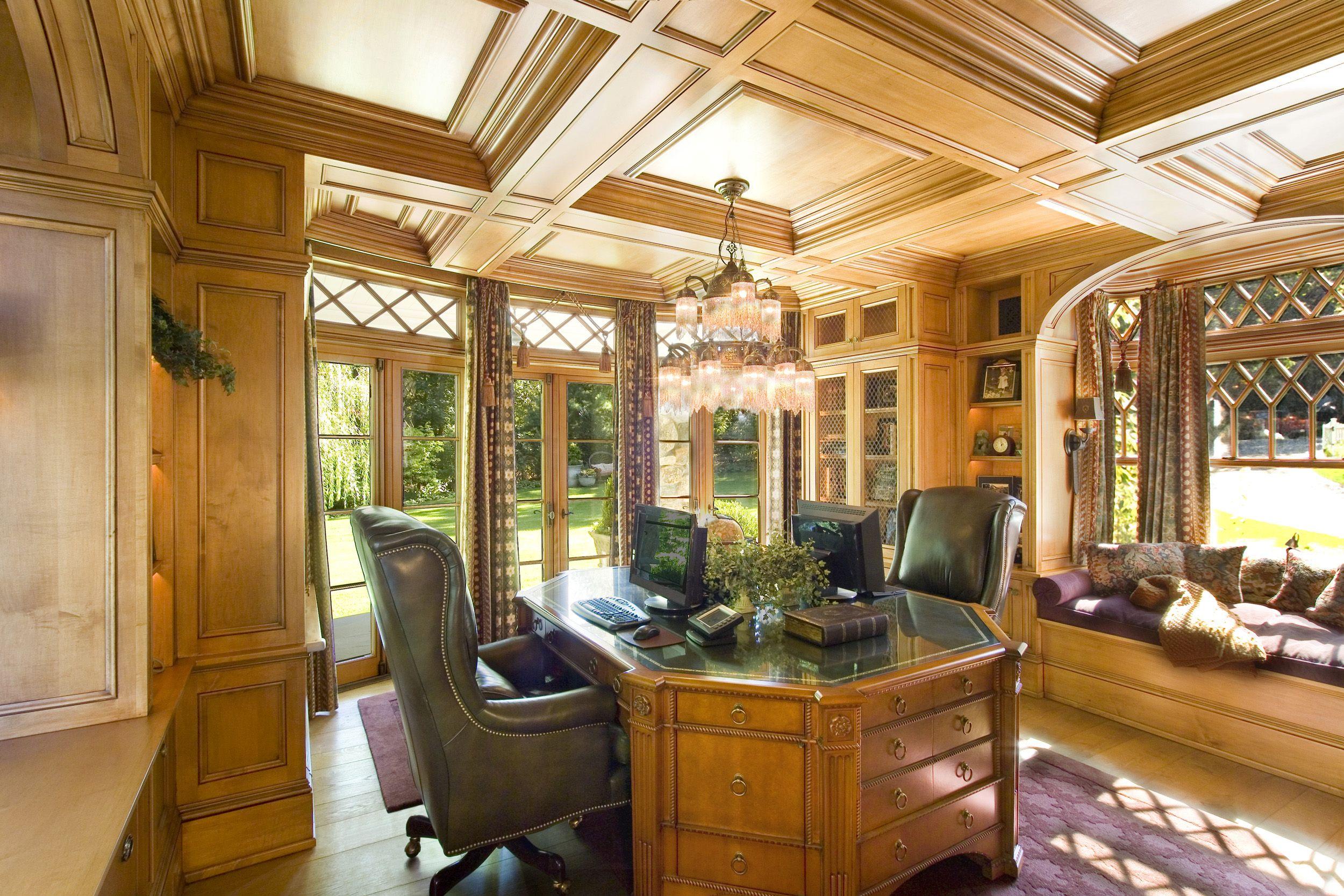 Luxury study featuring custom wood detailing.