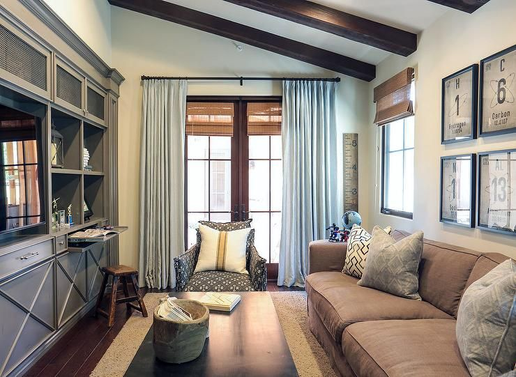 Family Room With Gray Built In Tv Cabinets Transitional Living Room Grey Stained Wood Wood Beam Ceiling Family Room #sloped #ceiling #living #room