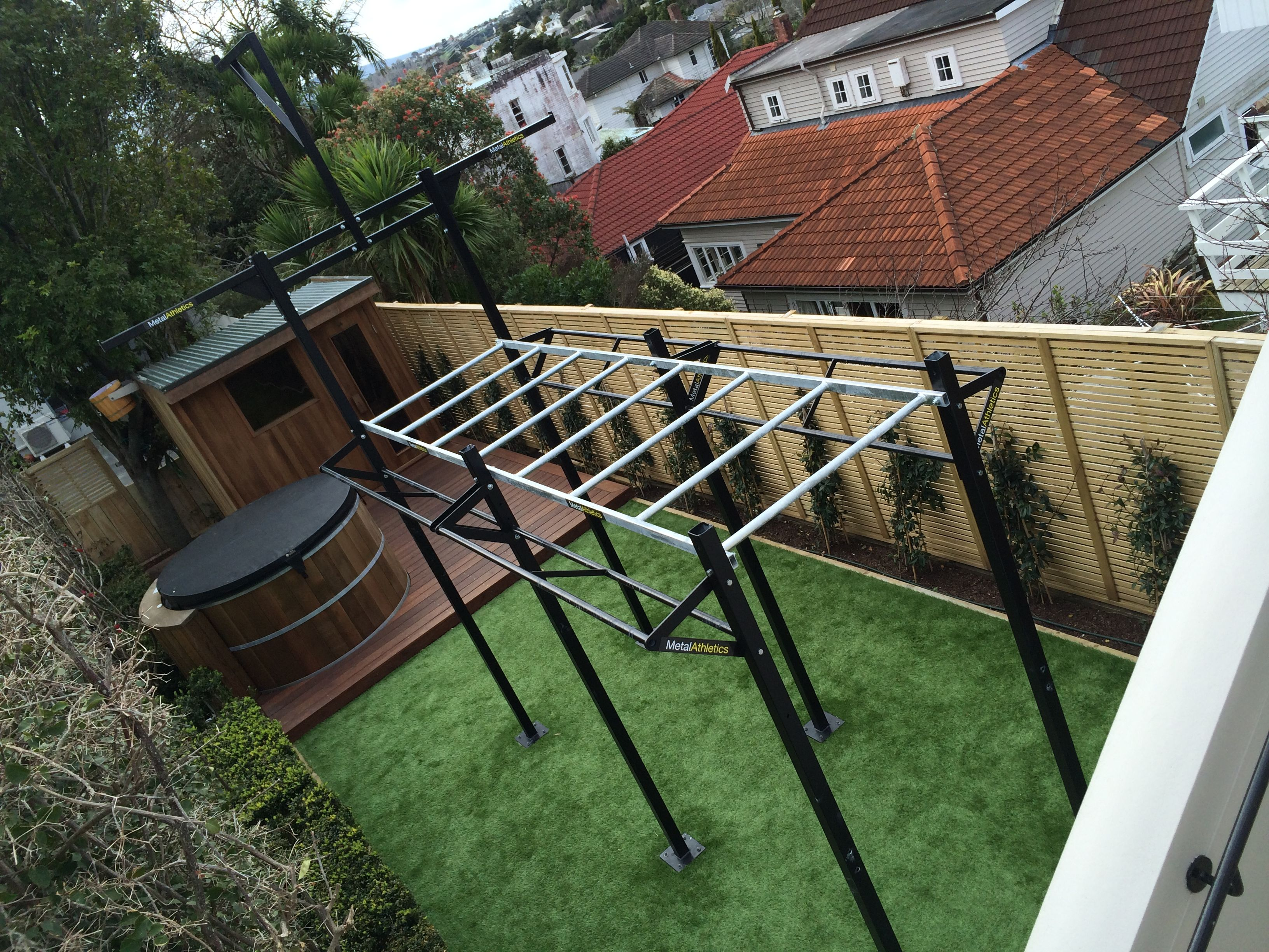 Outdoor monkey bar rig for a residential home gym in remuera