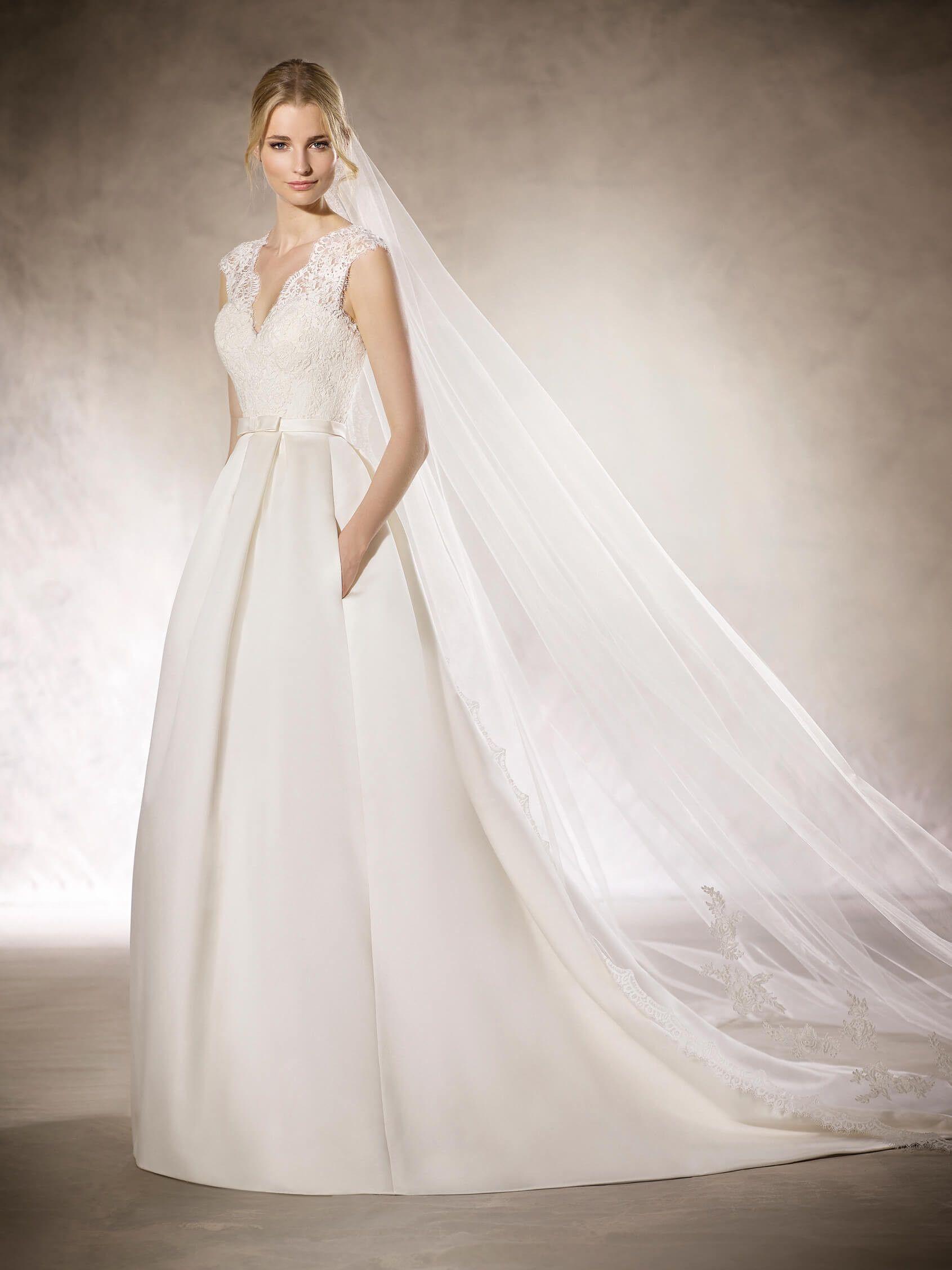 HYRIA is a spectacular princess wedding dress with a V-neckline and ...