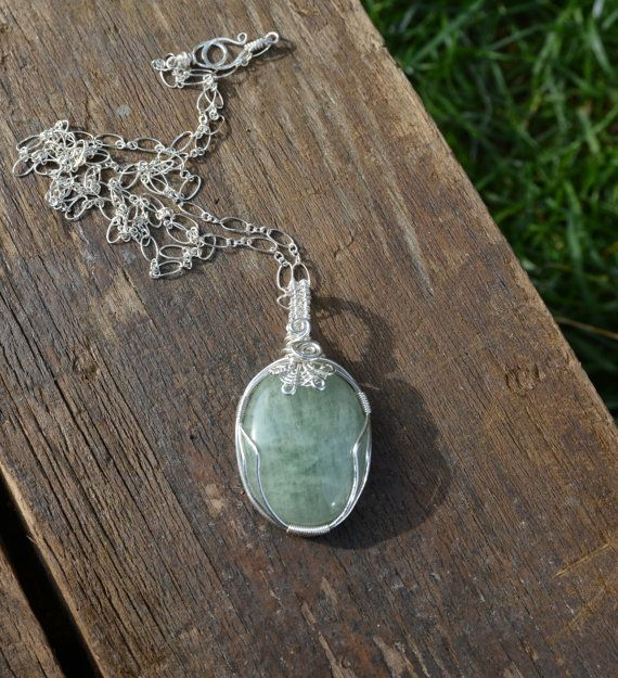 This gorgeous untreated aquamarine cabochon is lovingly wrapped in sterling silver wire. Stone Description: Aquamarine evokes the purity of