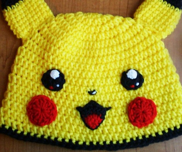 1ad9032801d79 Stay warm and fashionable like a true Pokemon master with this Pikachu  crocheted beanie. Handmade entirely from yarn