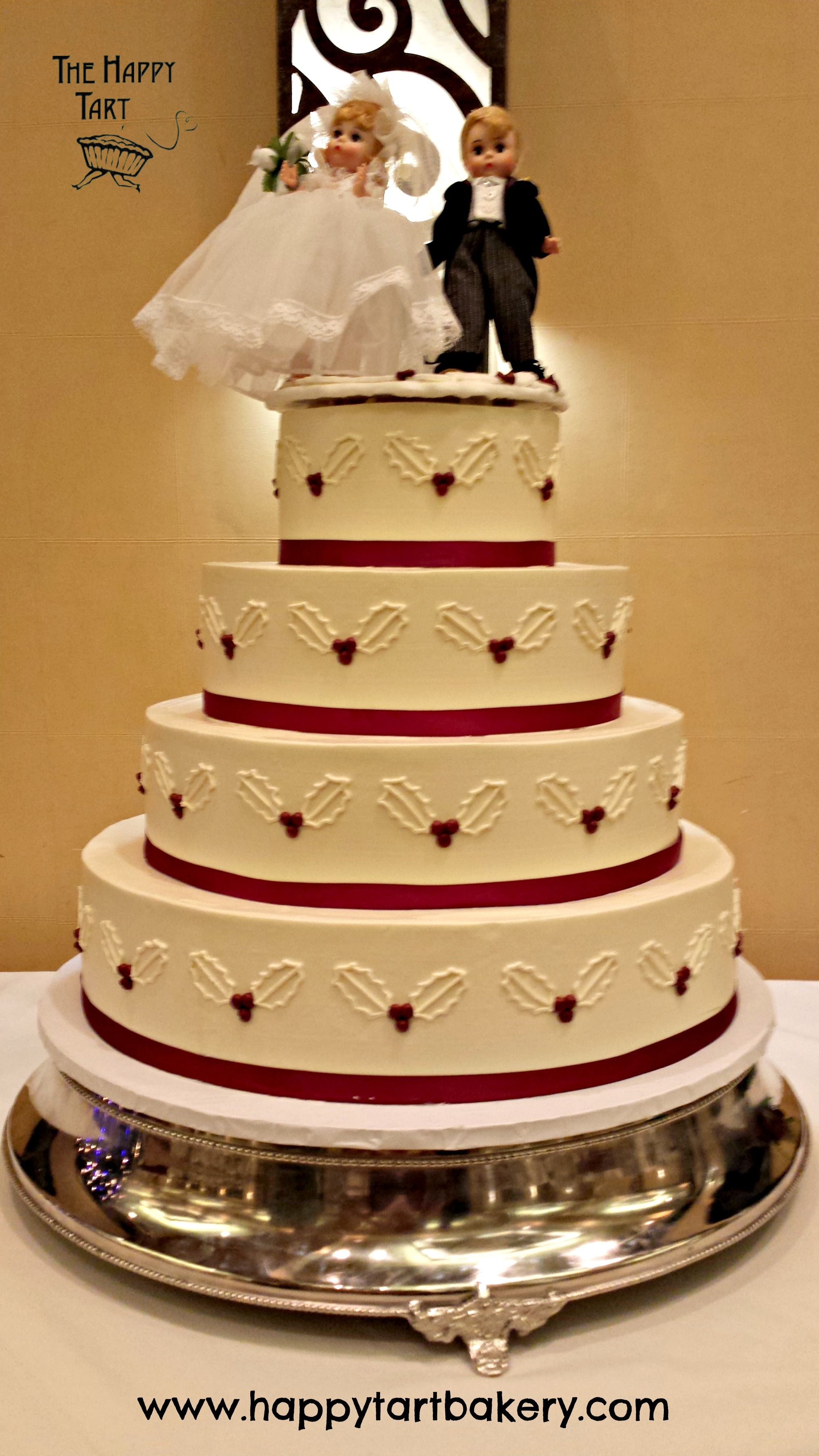 Gluten Free Ercream Wedding Cake With Holly Leaves And Crimson Ribbon