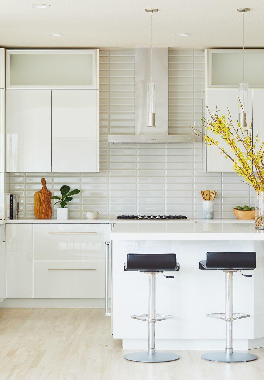 A Dramatic White And Gray Modern Kitchen Remodel Interior Designer Des Moines Jillian Lare White Modern Kitchen High Gloss Kitchen Cabinets Modern Kitchen Remodel