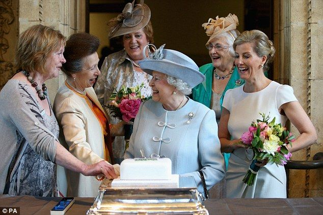 More tea, maam? The Queen attending her first WI meeting in 1953