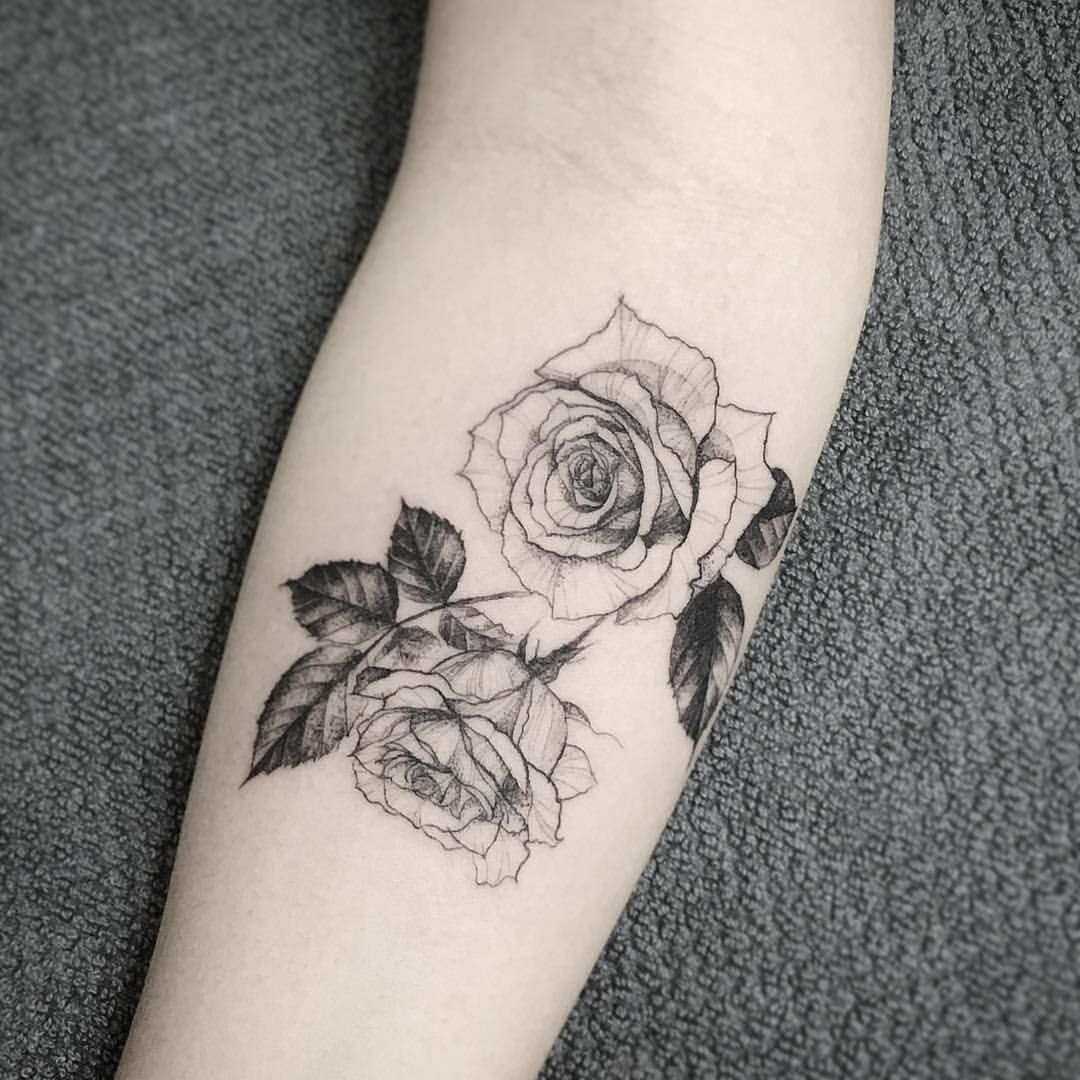 A little spiderwebby but still nice rose shoulder for White rose tattoo