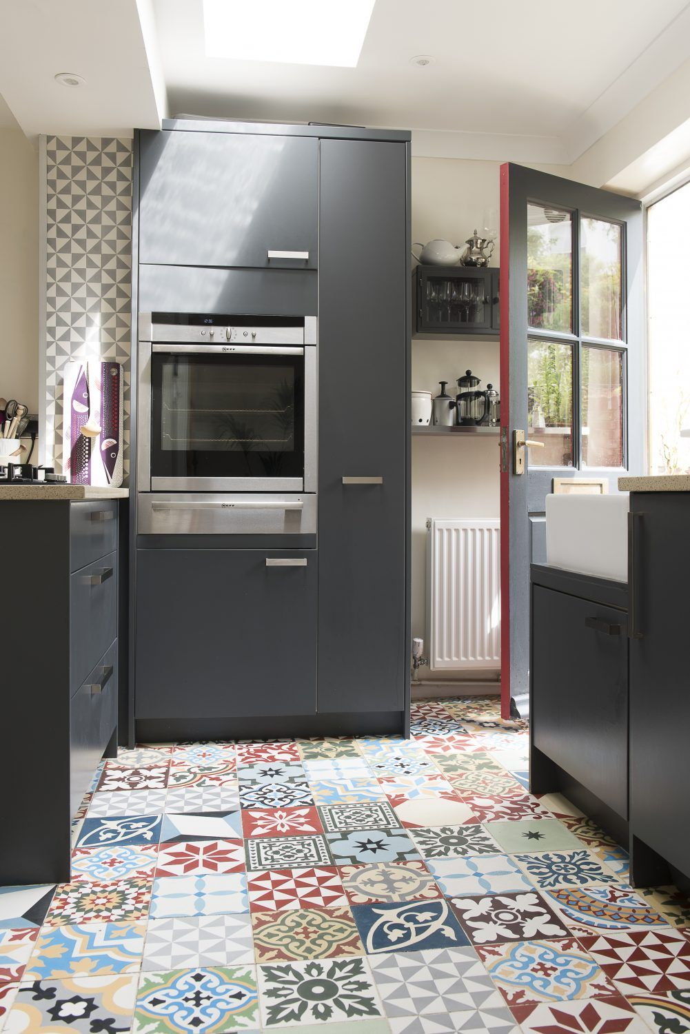 The Front Door Opens Into The Kitchen The Units Are From Jewsons And The Encaustic Tiles Are From Encaustic Tiles Ltd House Interior Kitchen Cabinets