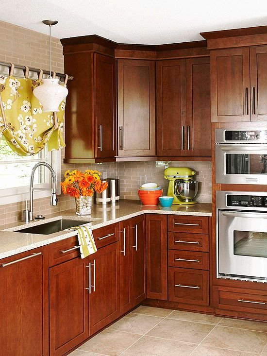 Mainstream Beauty Rich Cherry Cabinets With Oversize Hardware A Glass Tile Backsplash And Quartz Cherry Cabinets Kitchen Kitchen Renovation Kitchen Remodel