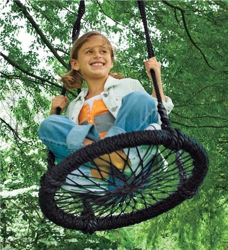 Round-and-Round Swing | This unique Round-and-Round Tree Swing brings the excitement of your child's favorite playground tire swing to your backyard. Kids can sit in a variety of positions on the hand-woven seat that features a tight weave so little hands and feet won't slip through.