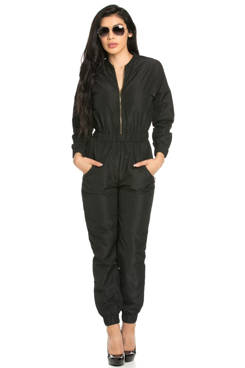 "The effortless long sleeved, woven black bomber jumpsuit with an exposed zip front. Features zip pockets on both hips, elastic cinched waist band, and elastic cinched wrist and ankle cuffs.    Fabric 100% Polyester; Contrast: 100% Polyester    Made In Imported    Care      	Machine wash cold water with like colors  	Gentle Cycle  	Dry Flat      Yuccie Babe ❤      	Height 5'10""  	Bust 32""  	Waist 25""  	Hips 35""  	Wearing Size: Small      Yuccie Babe ❤      	Height 5'8""  	Bust 35""  	Waist 25""…"