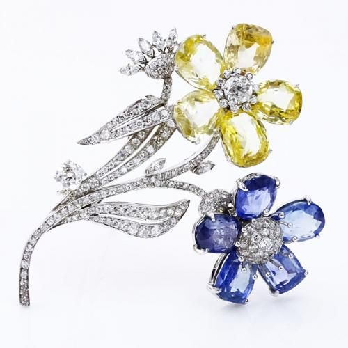 Art Deco Approx. Approx. 7.25 Carat Old European and Single Cut Diamond, 35.0 Carat Oval Cut Blue and Yellow Sapphire and Platinum Flower Brooch