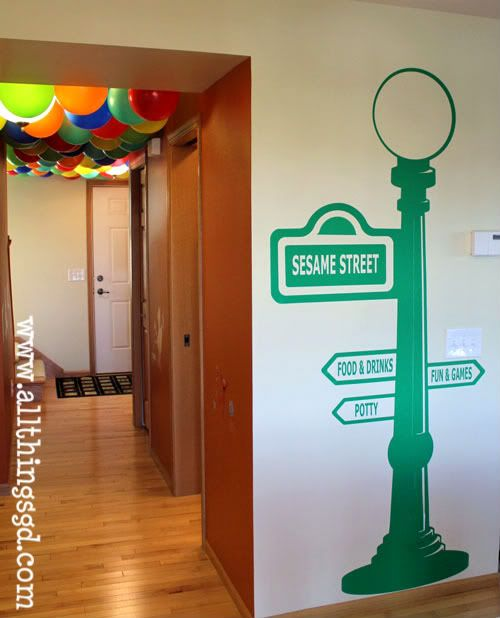 Sesame Street Birthday Party sign and the ceiling full of balloons ...