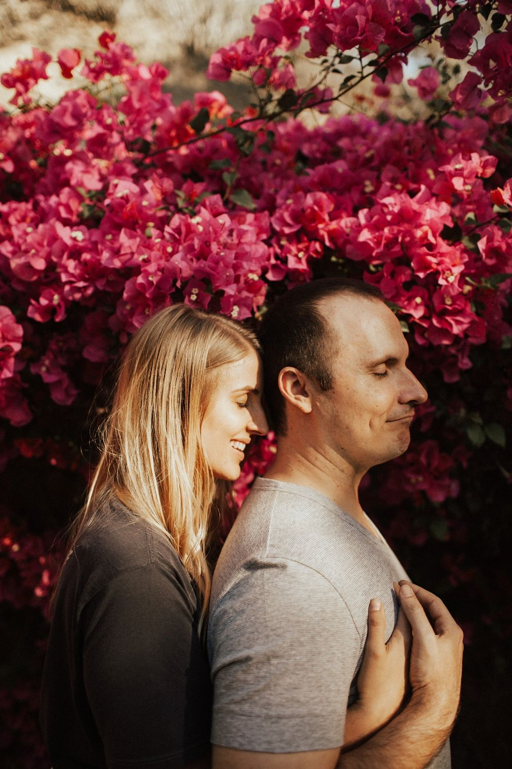 engagement photo with bougainvillea