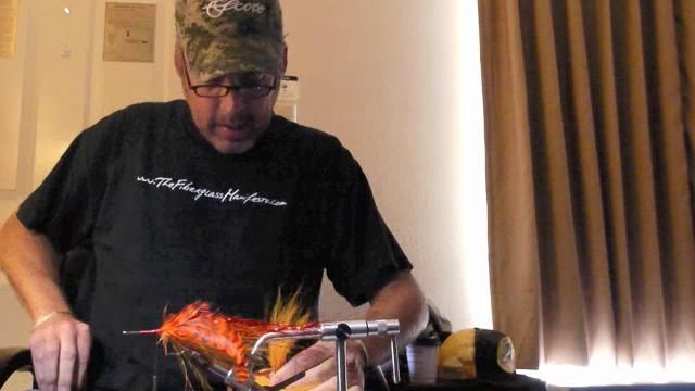 """S.C.O.F  spring 2012 - issue 3   Fur and Feather Matinee   double feature    BRAD BOHEN -  ties """"buford"""" in a hotel room filled with feathers  the morning after the Musky World Championship  for Southern Culture On the Fly"""