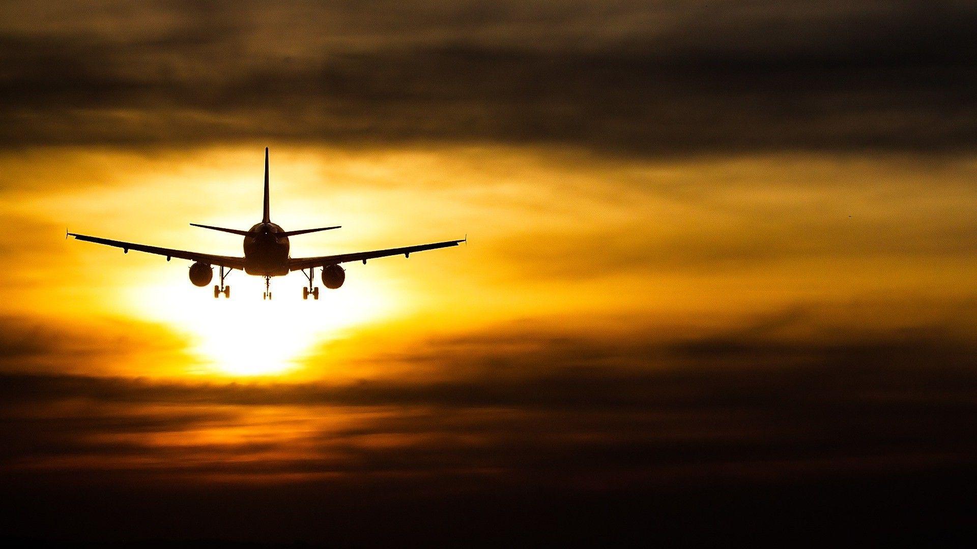 Sunset Passenger Plane Full HD Desktop Background