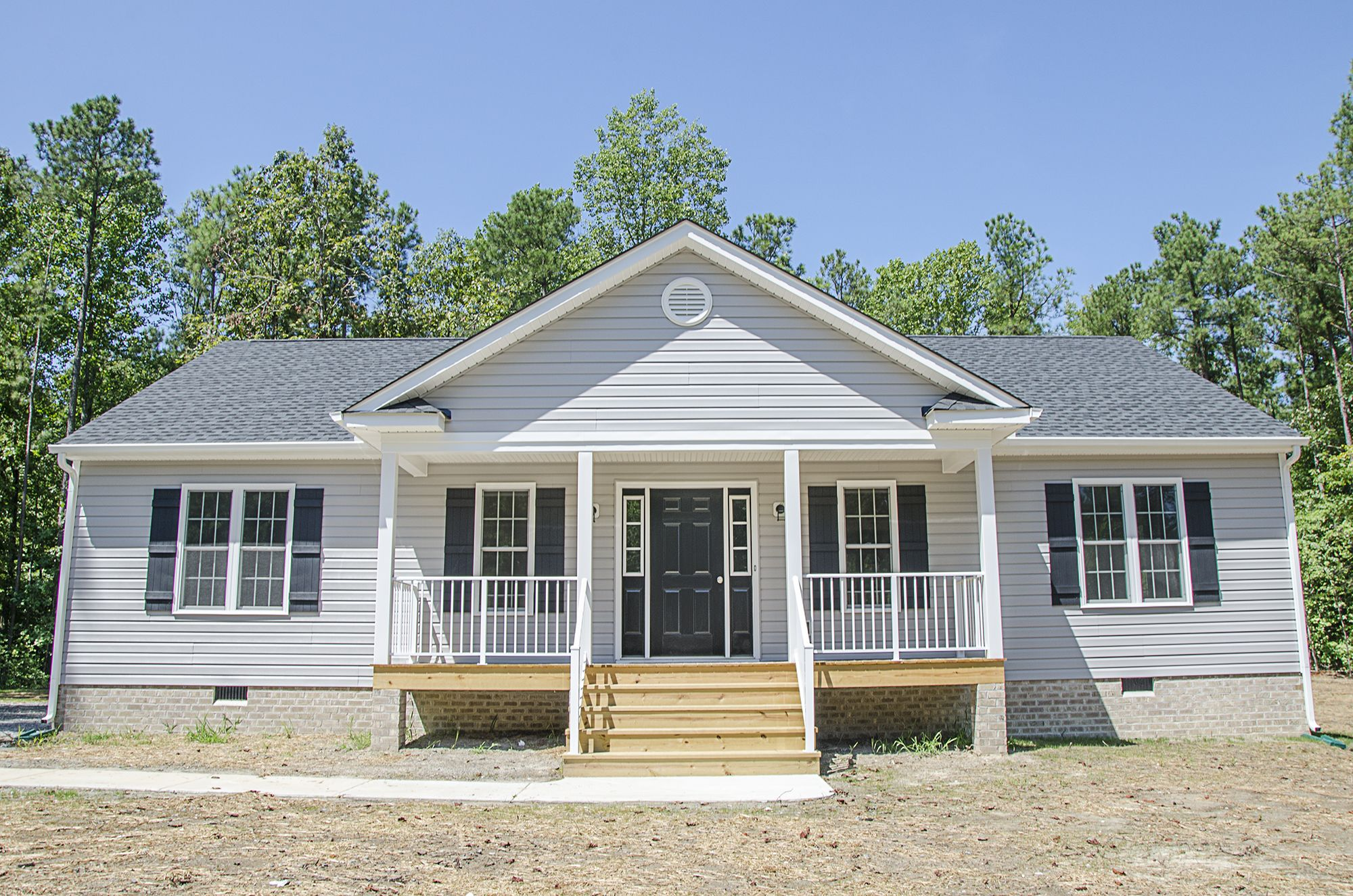Beautiful Ranch Style Home With Gray Siding And A Front Porch