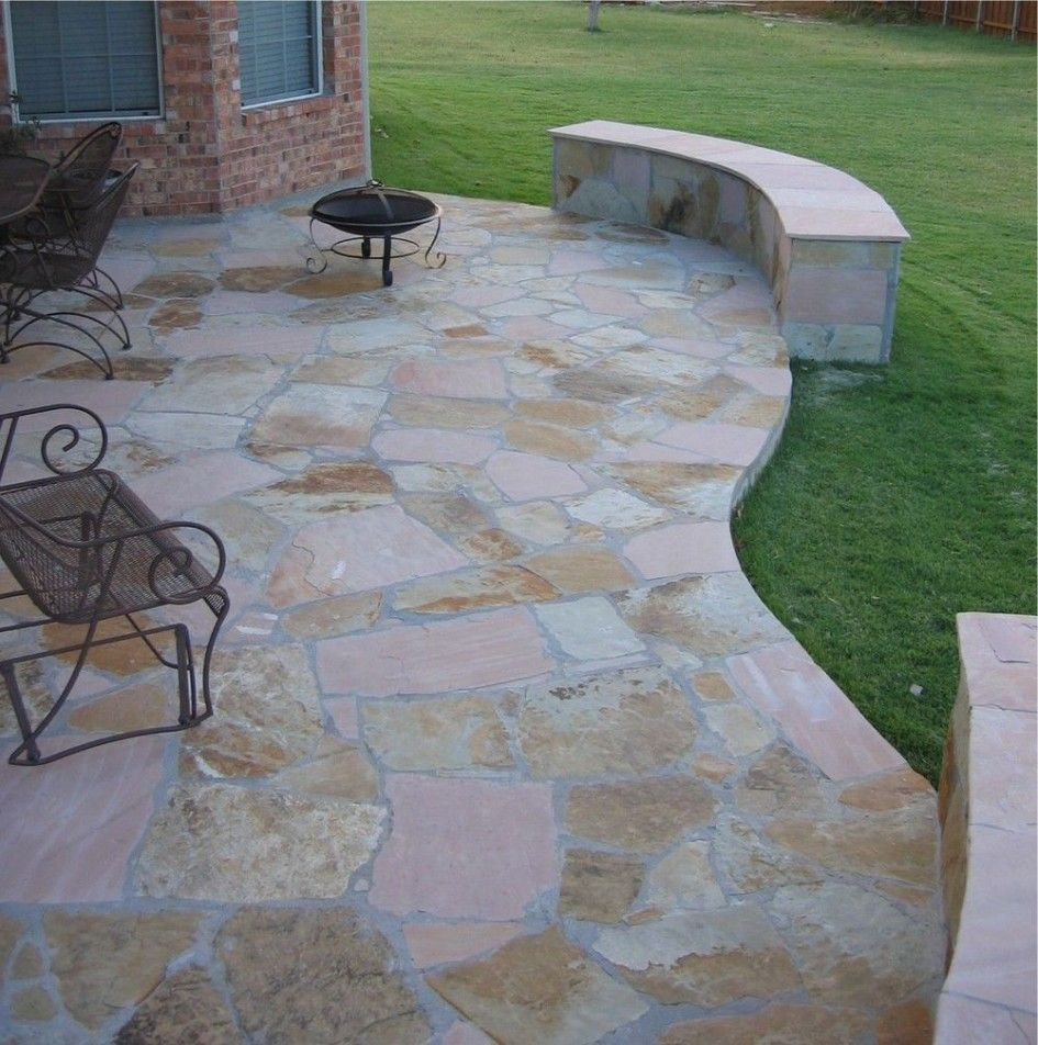 Gentil Curved Stone Outdoor Flooring Over Concrete Desin With Concrete Bench And  Metal Seating Aside Reddish Brick House