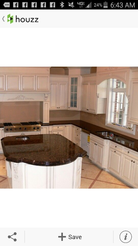 Tan Brown granite counters with white cabinets and peach/tan floors ...