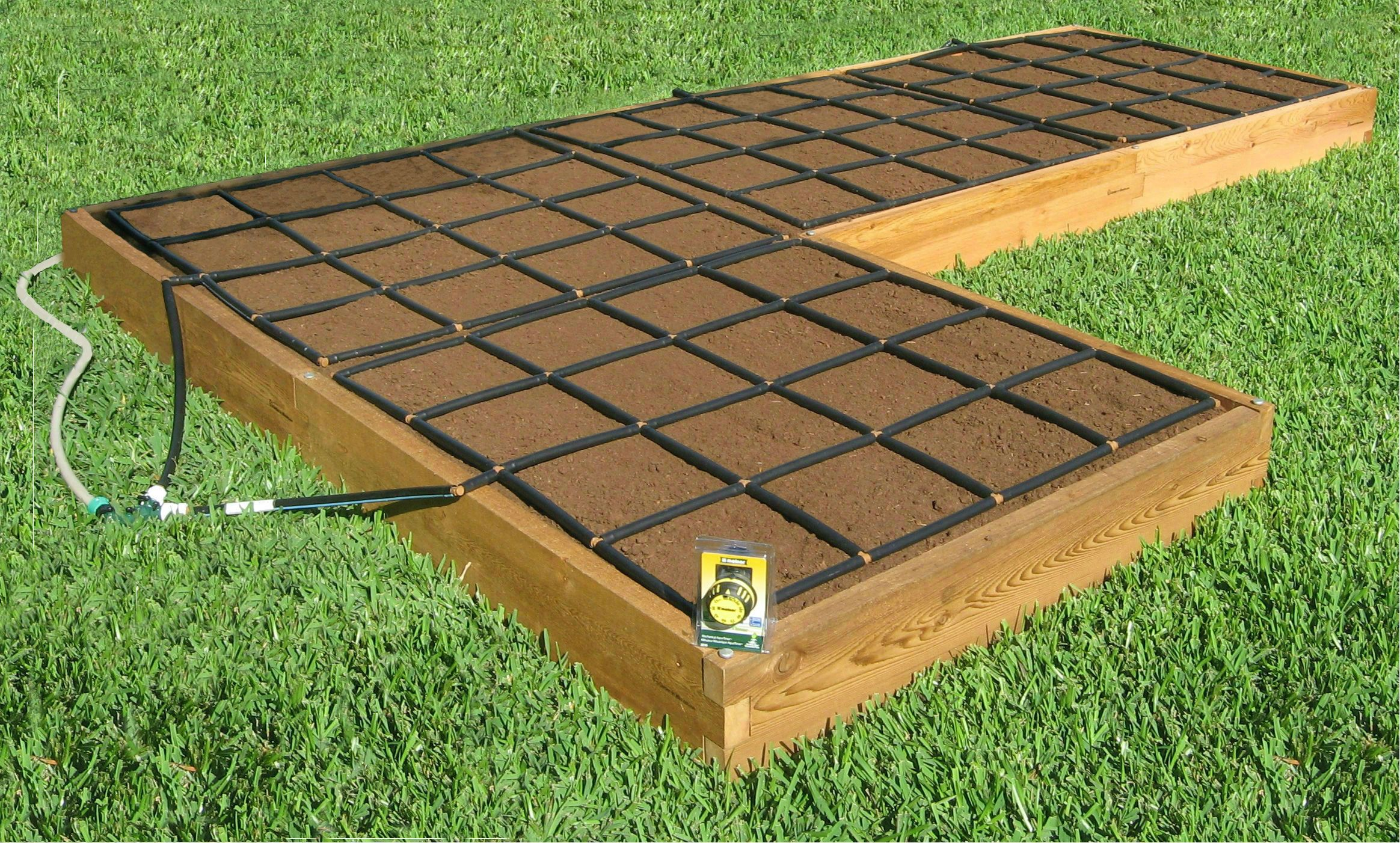 "the ""l"" shape raised garden kit with garden grid watering systems"