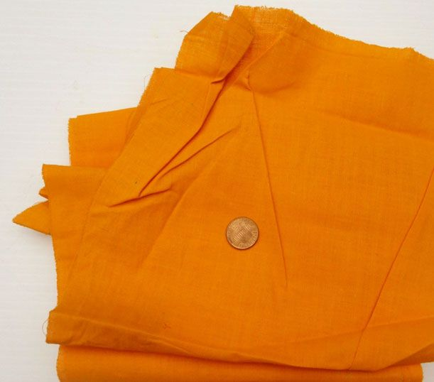 Vintage chrome orange cotton. It's often rather sleazy---low thread count.