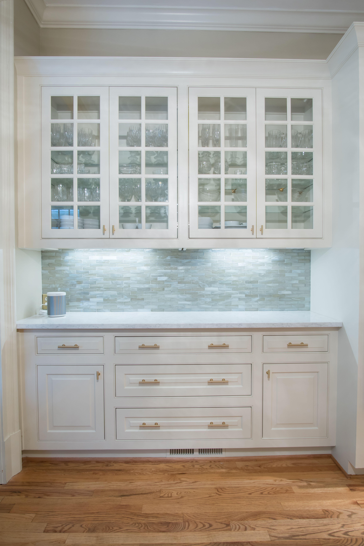 Custom built buffet , Quartz countertop, Glass doors, backsplash ...