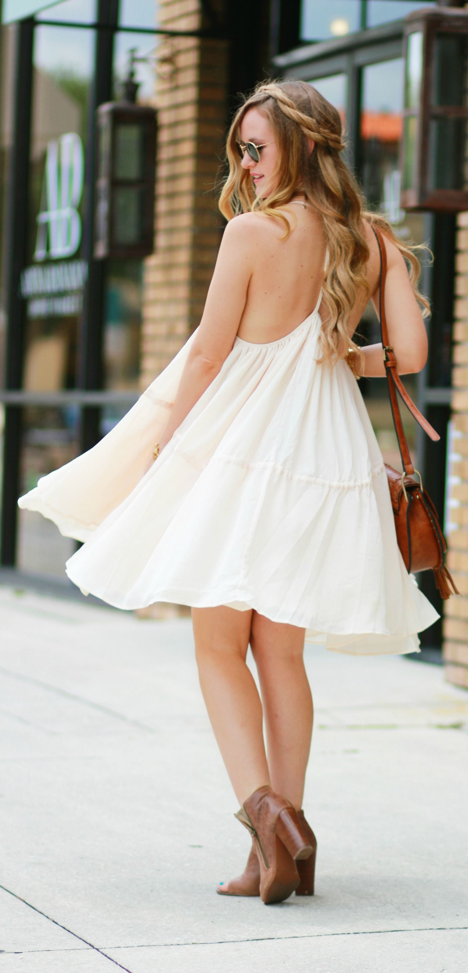 a140deb268 Flowy bohemian summer dress styled with peep toe booties and fringe Sancia  bag