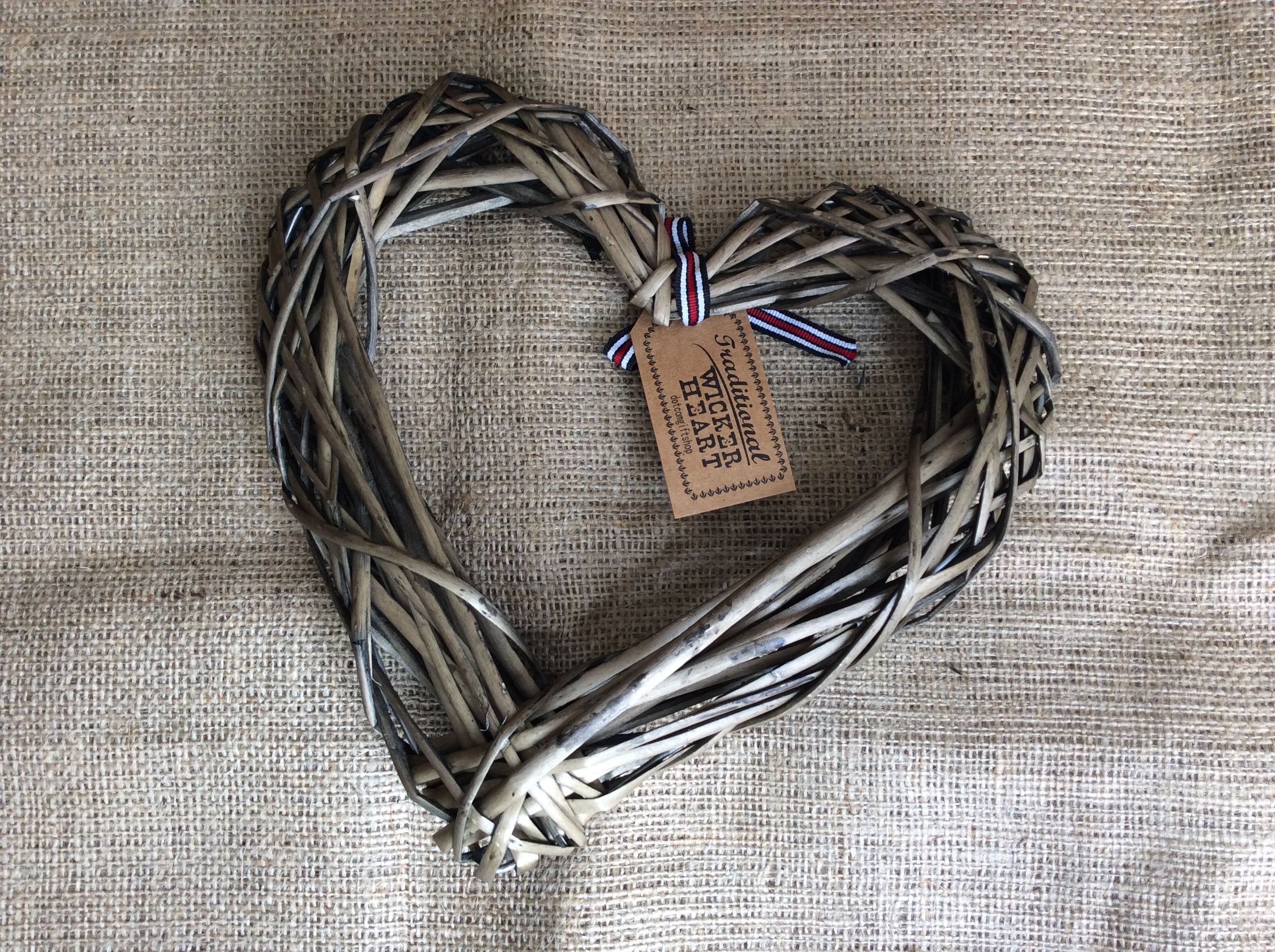 Pretty rustic style wicker heart with a stripped bow. The stunning ...