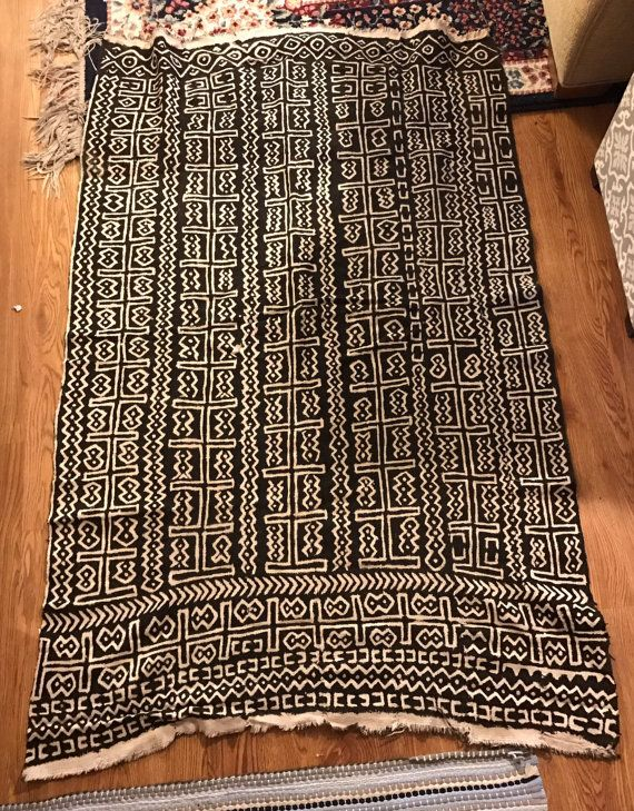 This is a handmade, vintage Nigerian rug. It features a traditional Nigerian pattern in white and black. The rug is medium-sized (36 x 57). The rug is thin. Please contact me if you have any questions! Sold as pictured.