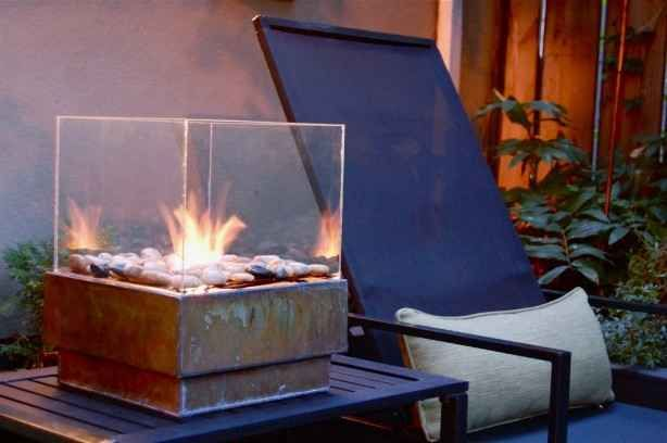 A Glass Encased Fire Pit Portable Fire Pits Outdoor Fire Home Diy