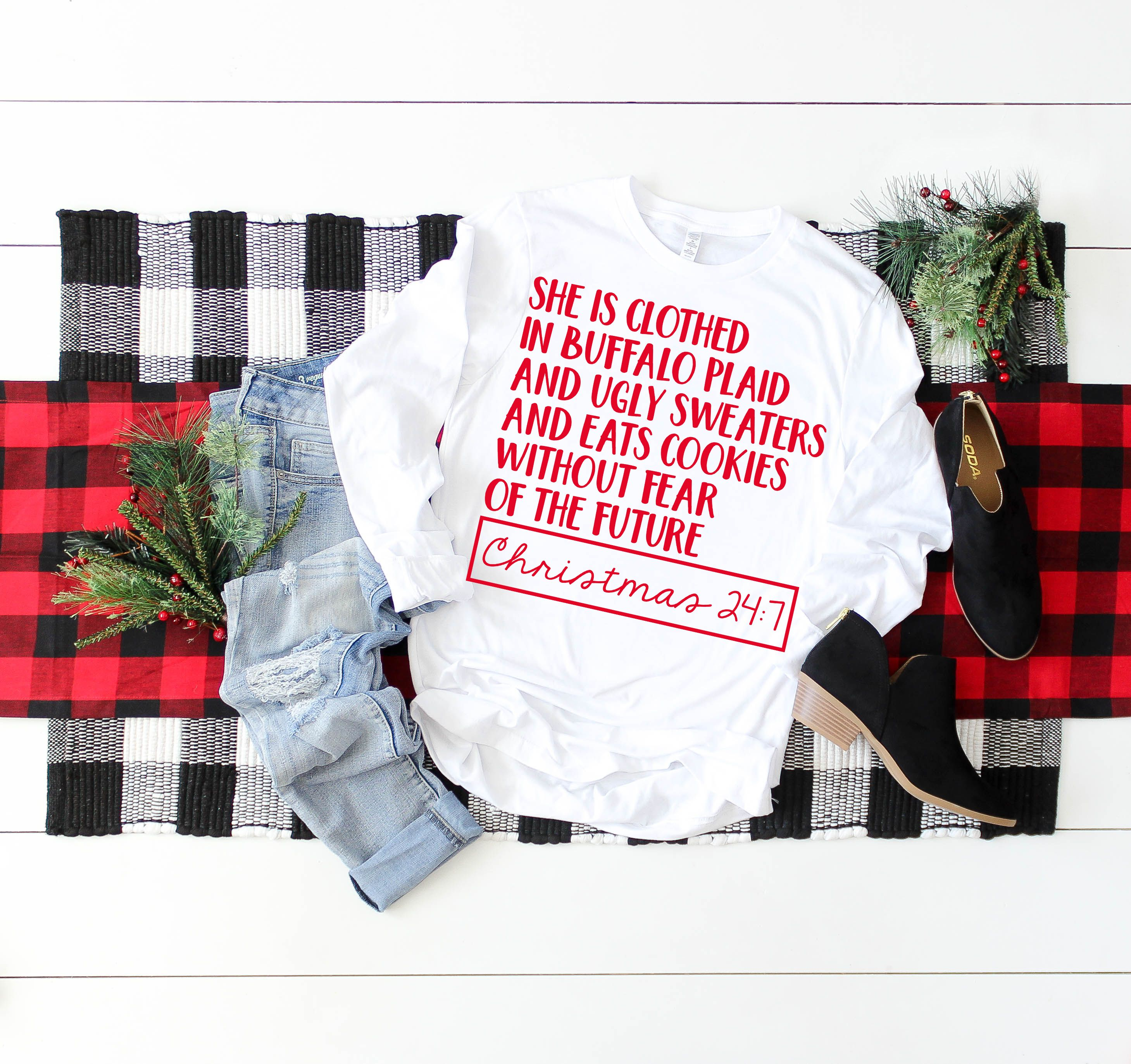 5589516f11 She is clothed in buffalo plaid and ugly sweaters and eats Christmas cookie  without fear of the future! HAHA!