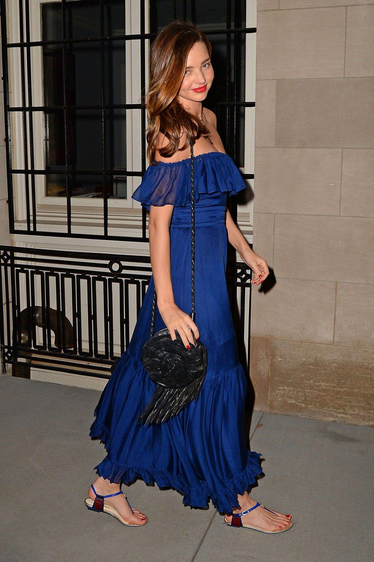 Miranda Kerr in a Gucci dress worn + Chanel sandals and a Valentino bag.